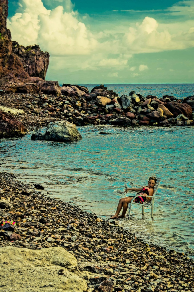 Girl Reclining At Cove Bay Beach, Saba, Dutch Caribbean
