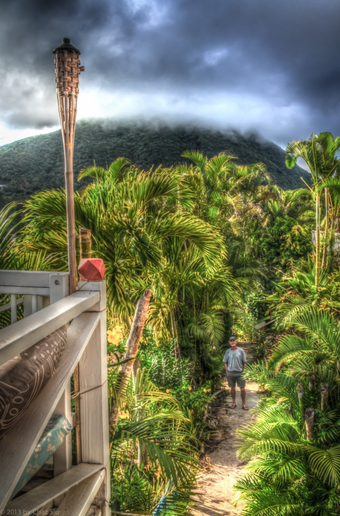 Irish Michael McAuliffe At The Entryway For El Momo Cottages As Mt Scenery Looms Above
