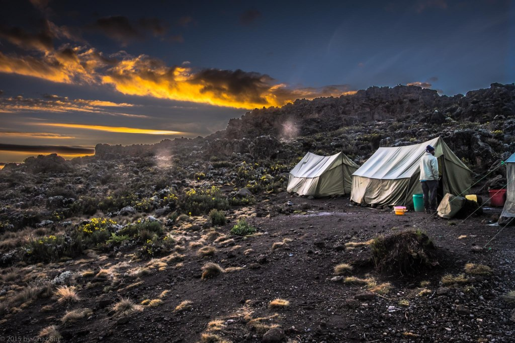 Cooking And Mess Tents At Sunrise - Third Cave. You can see the rock formations I climbed for the early AM photos of Kili.