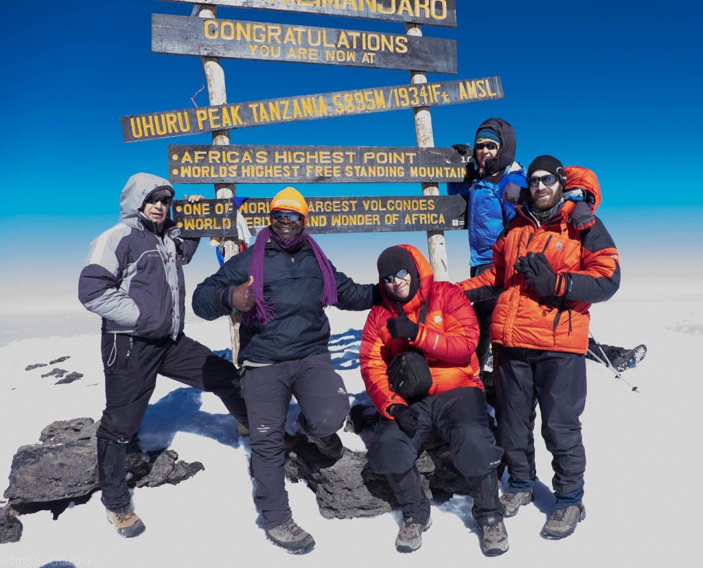 Uhuru Peak Summit - The Roof Of Africa. L to R, Alex, JT, me, Caryl, Paul. Rhys, Cort, and Kitt had summited an hour a head of us.